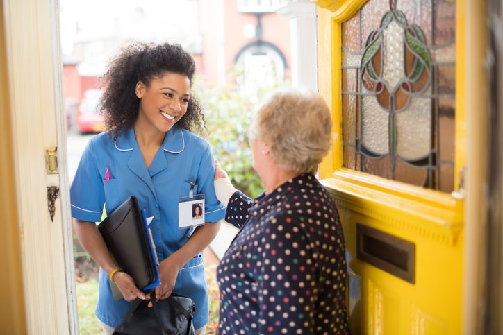 nurse arriving at home of senior patient
