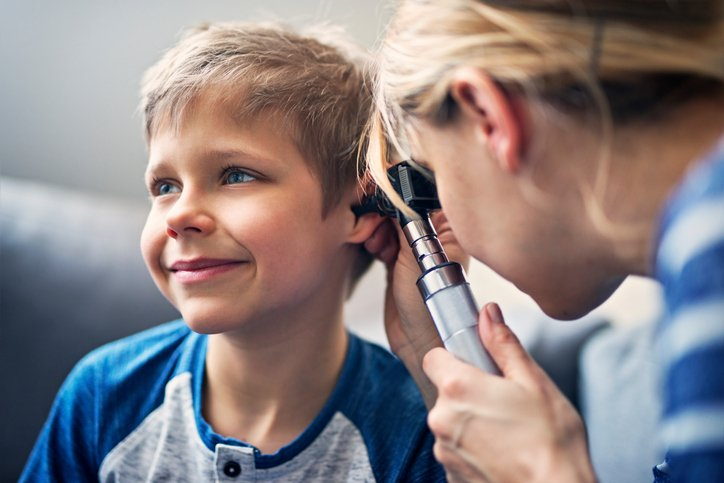 nurse checking pediatric patient ears